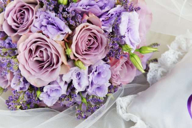 bride bouquet of purple flowers on white background